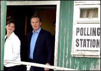 Tony Blair exits a polling booth with wife Cherie Blair. - Image courtesy of  labour.org.uk