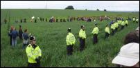 Indymedia Image: Police and public make strange lines among GE crops (www.indymedia.org.uk)