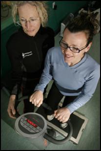 Dr Sue Broadbent (left) assists exercise science lecturer Sandie Choate on the Vibrogym platform