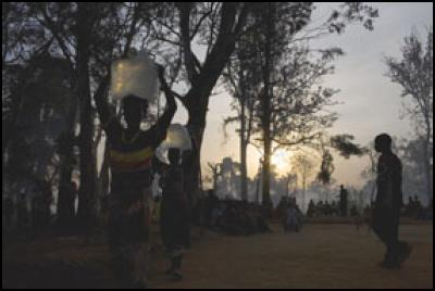 Mapuzi (12) and her mother collect water outside the displaced camp in Gety