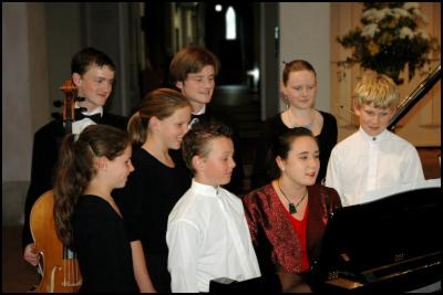 Central Auckland Youth Well Represented: Grace McMillan-Caires of Onehunga (at the piano) is joined by Esme and Verity Kennerley of Epsom, Austin Davies of Herne Bay, Henry Winder of Remuera and Ken, Tom and Nicola Walton of Epsom in rehearsal at Holy Trinity Cathedral.