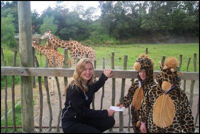 Kidsfirst children present cheque to Hazel Stone of Orana Wildlife Park