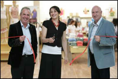 EziBuy founders, Gerard (left) and Peter Gillespie, and Silver Fern and Magic player, Joline Henry, officially open the new store in Hamilton last night