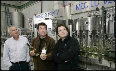 L-R - Jim Veitch,  Theo Giesen (without glasses) ,  Marcel Giesen   at the company's  recently  opened bottling plant.