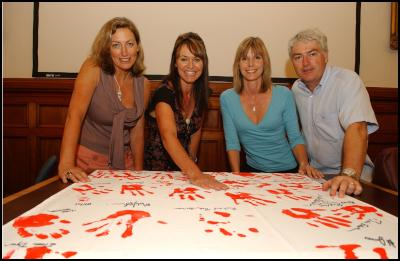From left: Media celebrities Deborah Coddington, Hilary Timmins, Jude Dobson and Mark Leishman pledge their support with hand prints.