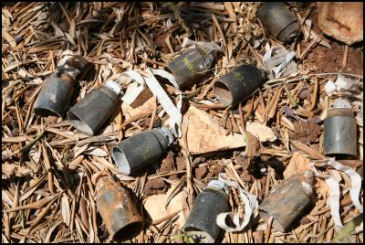 Cluster bombs found in an olive grove in Southern Lebanon. CREDIT: Simon Conway/ Landmine Action