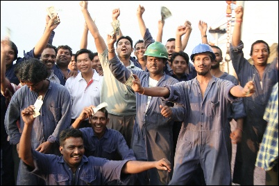 Estatic crew with SMOU President Capt Robin Foo waving their wages expressing great joy.