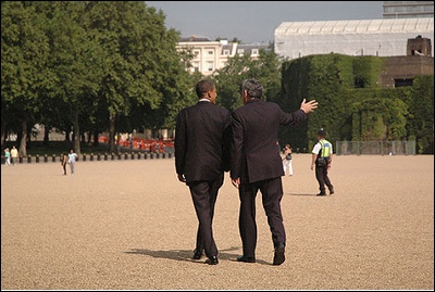 Mr Brown and Mr Obama walk across Horseguards in central London.