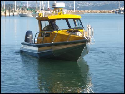 Hawea Tomoana at the helm of Matahorua, DOC's new patrol boat for the Taputeranga Marine Reserve: Photo: DOC