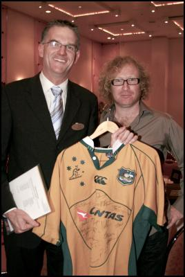 Brendon Meppem, Crowne Plaza Auckland General Manager stands proudly with his newly acquired autographed Wallabies rugby jersey alongside comedian Te Radar. Credit: Diana Sanders Photography