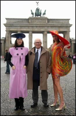 French fashion designer Pierre Cardin poses with models in front of Berlin's landmark Brandenburg Gate