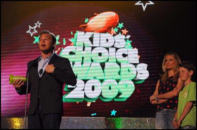 Leonardo DiCaprio accepts the Big Green Help Award at the 22nd Annual Kids' Choice Awards as Cameron Diaz watches on Saturday, March 28, 2009, in Los Angeles. (Katy Winn/AP Images for Nickelodeon)