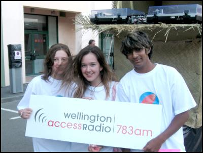 Wellington Access Radio Youth Zone presenters Tyler Bognuda, Bekkie Baxter and Sanjay Parbhu on an outdoor broadcast.