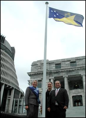 Labour Pacific MP's Luamanuvao Winnie Laban, Su'a William Sio and Carmel Sepuloni celebrate the new Tokelau flag flying on the Parliamentary forecourt