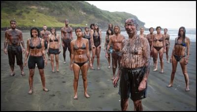 Harold Phillips, along with 19 other Greenpeace supporters at Muriwai beach who covered themselves in 'oil' to send a strong message to the Government to stop its plans for the drilling of new deep water oil wells off New Zealand's coast. © Greenpeace / Fraser Newman