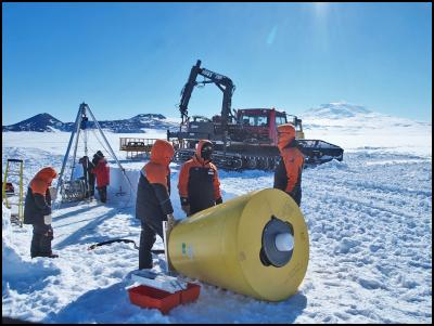 Ice Tethered Profiler being deployed in Antarctica by NIWA and Antarctica NZ staff.  Mount Erebus in the background.