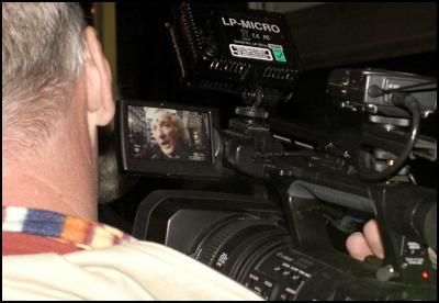 John Pilger on TV camera monitor