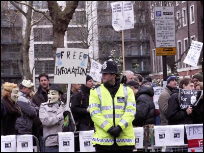 Protesters and policeman at bail hearing for Wikileaks' Julian Assanage.