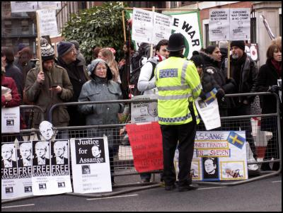 Police and protestors outside Julian Assange hearing