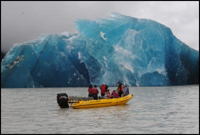 Mark Bascand from Glacier Explorers shows astounded passengers one of the many icebergs that calved into Tasman Lake today as a result of the earthquake.