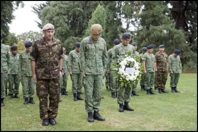 Singapore personnel, from SAF, alongside NZ Defence Force personnel lay a wreath in the Christchurch Botanic Gardens in memory of those who died in the Christchurch Earthquake.
