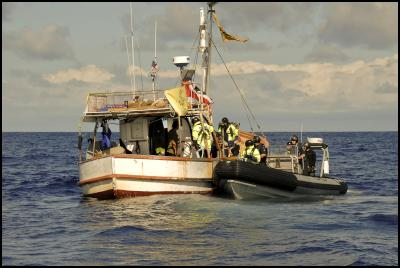 Tuesday, April 12, 2011. Police board the te Whanau a Apanui owned fishing vessel, San Pietro, off East Cape today to warn crew about approaching within set distances of the seismic survey ship Orient Explorer. The San Pietro is part of the flotilla opposing deep sea oil drilling.