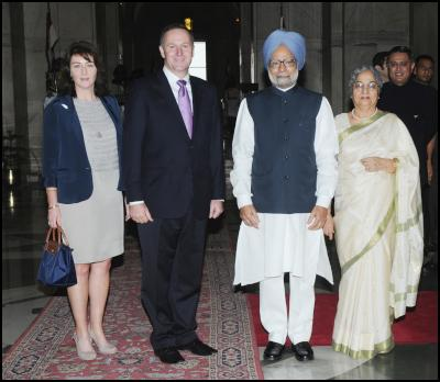 The Indian Prime Minister, Dr. Manmohan Singh with the Prime Minister of New Zealand, Mr. John Key, at his ceremonial reception, at Rashtrapati Bhawan, in New Delhi on June 28, 2011. Smt. Gursharan Kaur and Mrs. Bronagh Key a