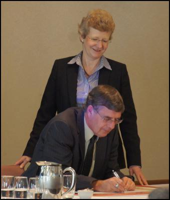 Conservation Minister Kate Wilkinson witnesses the signing of the Accord by Professor Bruce Clarkson