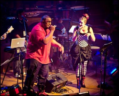 Lui Fauolo (L) and Tamsyn Miller (R) perform at Remix the Orchestra: Full Orchestra Meets Hip-Hop. Auckland Town Hall, 31 May 2012. Image by Oliver Rosser.