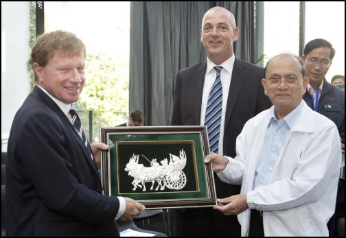 Fonterra's Chairman John Wilson and CEO Theo Spierings being presented with a gift from Myanmar President Thein Sein.