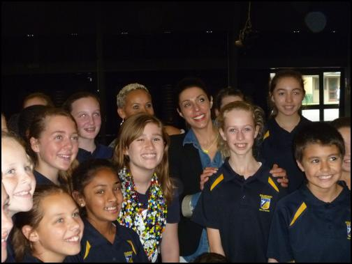CCF child ambassador Kelcey Roberts with Truebliss band members Megan Alatini and Erikia Takacs, and school children from Bucklands Beach Intermediate.