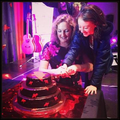 Victoria Spackman and Nova Waretini Hewison cut 25 birthday cake image by Jennifer OSullivan