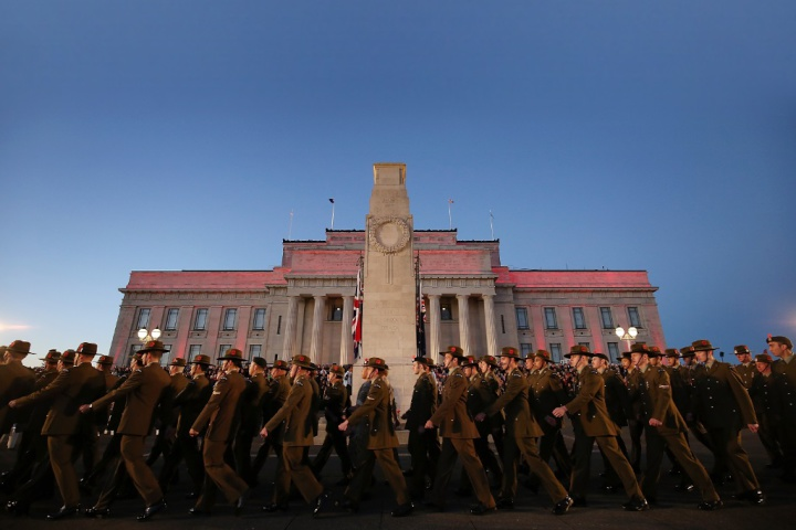 soldier marching in front of the auckland war memorial museum