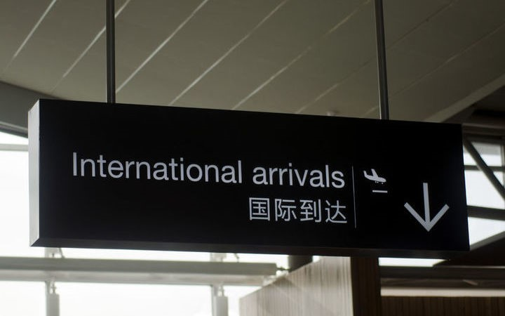 the sign for Internation Arrivals at an Airport
