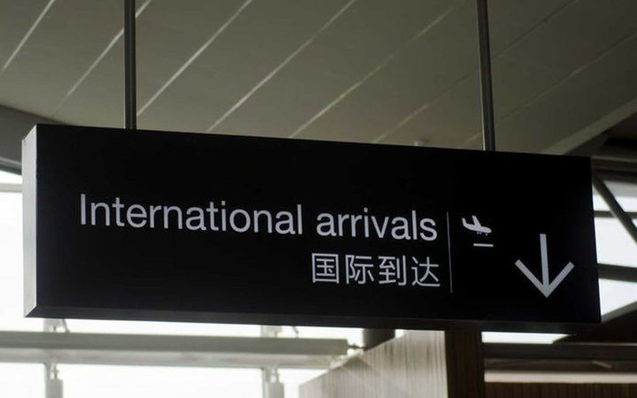an international arrivals sign at an airport