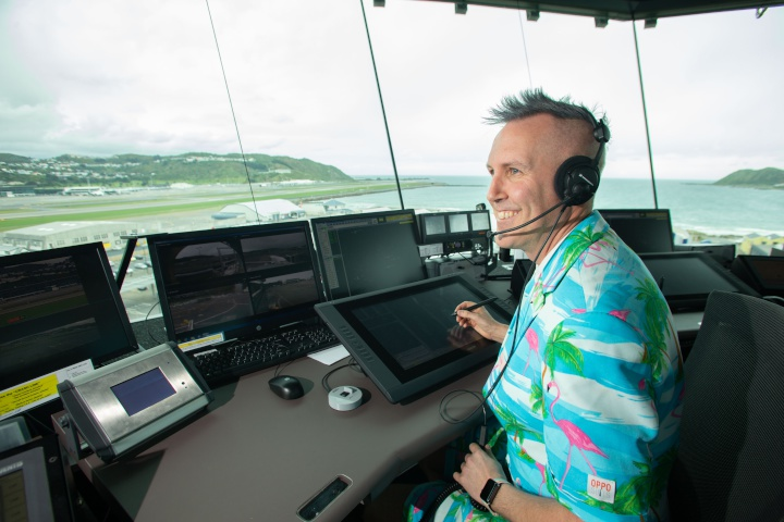 Senior Wellington air traffic controller Nathan O'Keeffe sits on position in the new Wellington air traffic control tower.