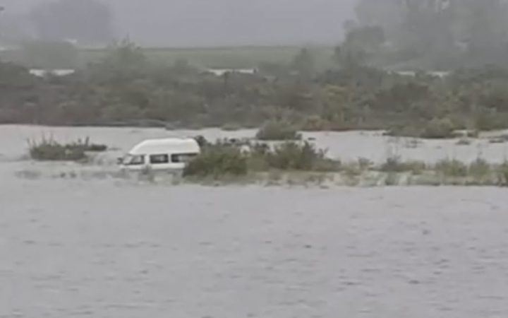 half submerged camper van