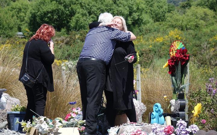 Sonya Rockhouse receives a hug from Bernie Monk at Atarau, a memorial site near the Pike River Mine.