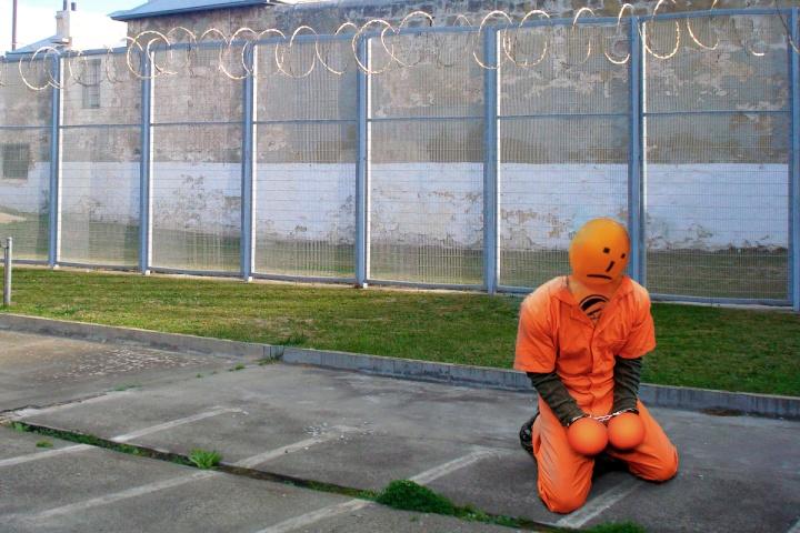 orange election mascot in prison