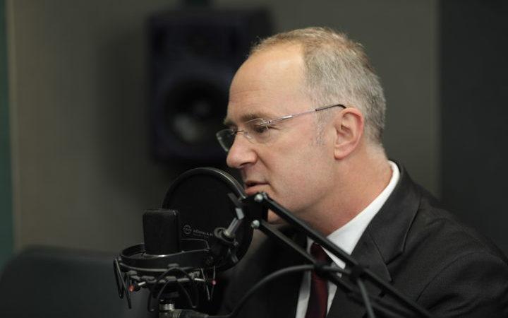 Phil Twyfoprd talking into a radio microphone