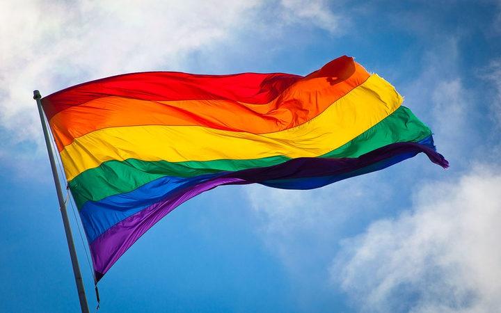 the rainbow flag, flying on a sunny day
