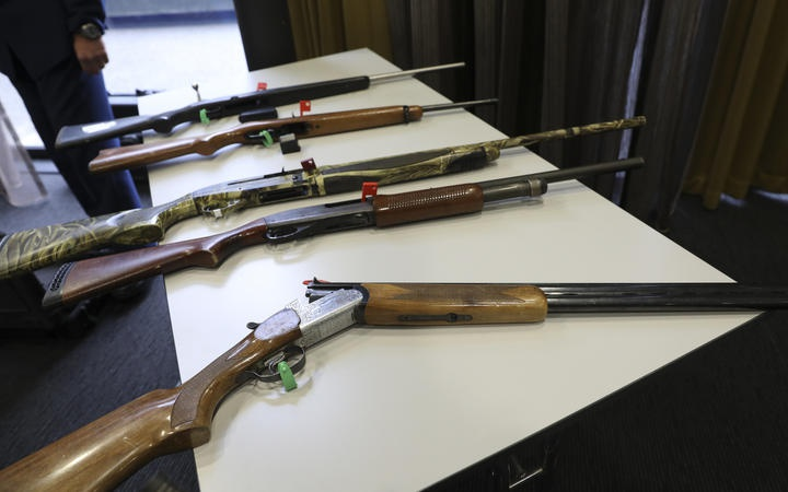 various rifles on a table
