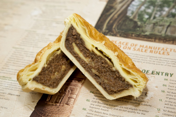 cut to show the filling – pieces of cheese are layered through the mince