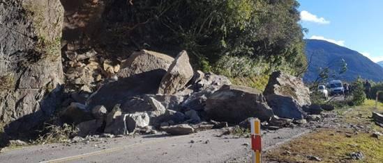 a large fall of big rocks across a road