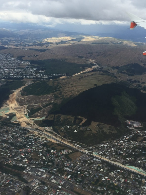 a photo from the air showing clear dirt amond the hills between areas with houses