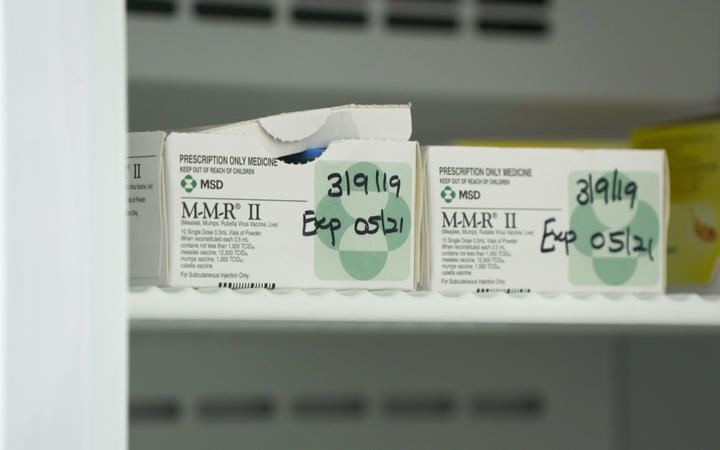 two boxes of MMR vaccine on a shelf