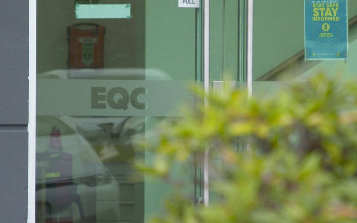 EQC signwriting on an office window