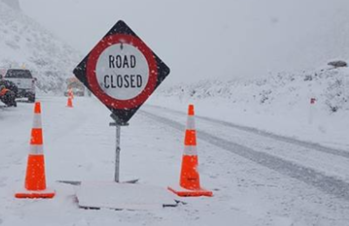 a road closed sign in snow