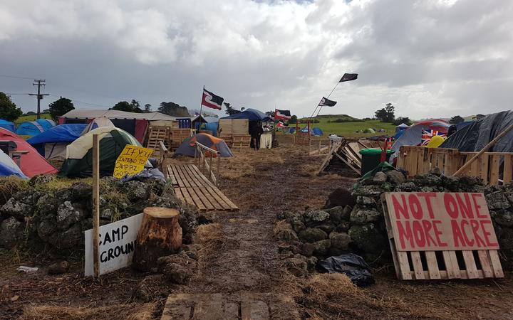 campground at the protest site, with thents, placards and flags