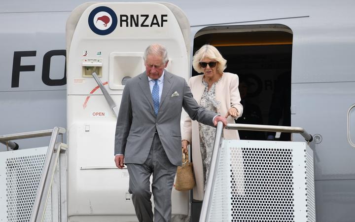 Prince Charles and the Duchess of Cornwall exiting the door of an RNZAF aricraft